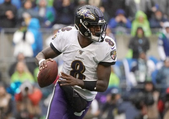 Oct 20, 2019; Seattle, WA, USA; Baltimore Ravens quarterback Lamar Jackson (8) throws a pass in the second quarter against the Seattle Seahawks  at CenturyLink Field. Mandatory Credit: Kirby Lee-USA TODAY Sports