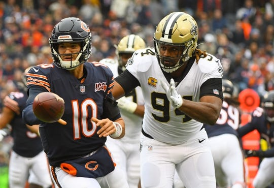 Oct 20, 2019; Chicago, IL, USA; Chicago Bears quarterback Mitchell Trubisky (10) throws the ball against New Orleans Saints defensive end Cameron Jordan (94) during the first half at Soldier Field. Mandatory Credit: Mike DiNovo-USA TODAY Sports