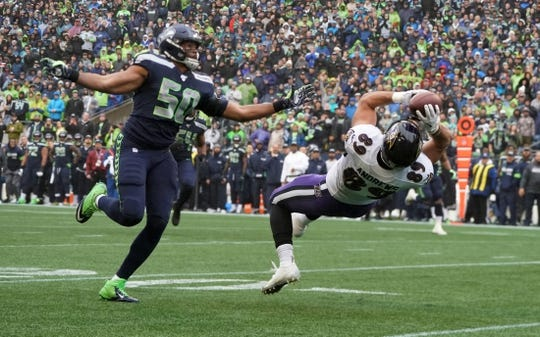 Oct 20, 2019; Seattle, WA, USA; Baltimore Ravens tight end Mark Andrews (89) is defended by Seattle Seahawks outside linebacker K.J. Wright (50) on a 33-yard reception in the second quarter at CenturyLink Field. Mandatory Credit: Kirby Lee-USA TODAY Sports