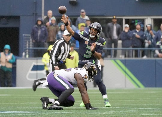 Oct 20, 2019; Seattle, WA, USA; Seattle Seahawks quarterback Russell Wilson (3) throws a pass against the Baltimore Ravens in the first half at CenturyLink Field. Mandatory Credit: Kirby Lee-USA TODAY Sports