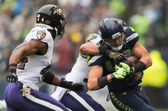 Oct 20, 2019; Seattle, WA, USA; Seattle Seahawks tight end Jacob Hollister (48) is tackled by the Baltimore Ravens during the first half at CenturyLink Field. Mandatory Credit: Steven Bisig-USA TODAY Sports