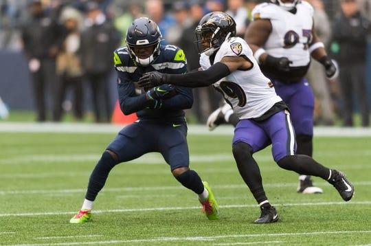 Oct 20, 2019; Seattle, WA, USA; Seattle Seahawks wide receiver Malik Turner (17) tries to break away from Baltimore Ravens cornerback Brandon Carr (39) during the first half at CenturyLink Field. Mandatory Credit: Steven Bisig-USA TODAY Sports