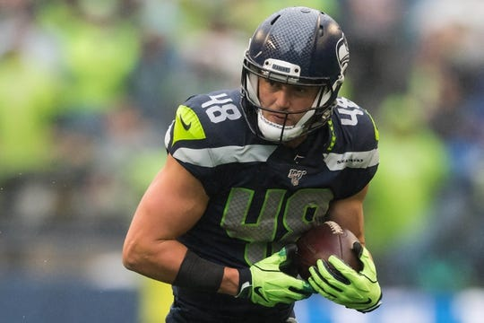 Oct 20, 2019; Seattle, WA, USA; Seattle Seahawks tight end Jacob Hollister (48) carries the ball after a catch against the Baltimore Ravens during the first half at CenturyLink Field. Mandatory Credit: Steven Bisig-USA TODAY Sports