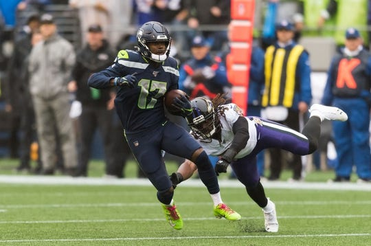 Oct 20, 2019; Seattle, WA, USA; Seattle Seahawks wide receiver Malik Turner (17) breaks a tackle attempt by Baltimore Ravens middle linebacker Josh Bynes (57) during the first half at CenturyLink Field. Mandatory Credit: Steven Bisig-USA TODAY Sports