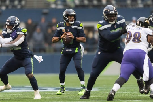 Oct 20, 2019; Seattle, WA, USA; Seattle Seahawks quarterback Russell Wilson (3) during the first half against the Baltimore Ravens at CenturyLink Field. Mandatory Credit: Steven Bisig-USA TODAY Sports