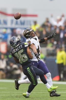 Oct 20, 2019; Seattle, WA, USA; Seattle Seahawks wide receiver Tyler Lockett (16) catches a pass over Baltimore Ravens cornerback Marlon Humphrey (44) during the first half at CenturyLink Field. Mandatory Credit: Steven Bisig-USA TODAY Sports