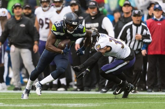 Oct 20, 2019; Seattle, WA, USA; Seattle Seahawks wide receiver David Moore (83) breaks away from Baltimore Ravens cornerback Brandon Carr (39) during the first half at CenturyLink Field. Mandatory Credit: Steven Bisig-USA TODAY Sports