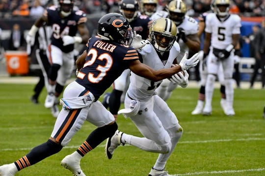 Oct 20, 2019; Chicago, IL, USA; New Orleans Saints wide receiver Michael Thomas (13) runs against Chicago Bears cornerback Kyle Fuller (23) during the first half at Soldier Field. Mandatory Credit: Matt Marton-USA TODAY Sports