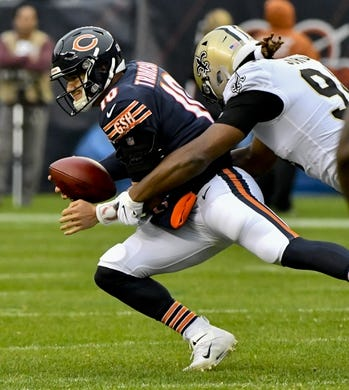 Oct 20, 2019; Chicago, IL, USA; Chicago Bears quarterback Mitchell Trubisky (10) is sacked by New Orleans Saints defensive end Cameron Jordan (94) during the first half at Soldier Field. Mandatory Credit: Matt Marton-USA TODAY Sports