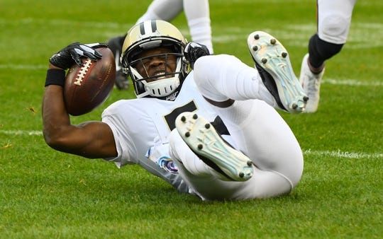 Oct 20, 2019; Chicago, IL, USA; New Orleans Saints quarterback Teddy Bridgewater (5) rushes the ball for a first down against the Chicago Bears during the first half at Soldier Field. Mandatory Credit: Mike DiNovo-USA TODAY Sports