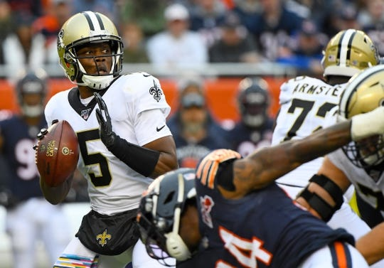 Oct 20, 2019; Chicago, IL, USA; New Orleans Saints quarterback Teddy Bridgewater (5) drops back to a pass against the Chicago Bears during the first half at Soldier Field. Mandatory Credit: Mike DiNovo-USA TODAY Sports