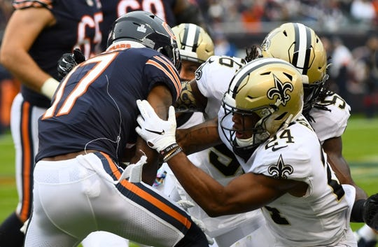 Oct 20, 2019; Chicago, IL, USA; New Orleans Saints strong safety Vonn Bell (24) causes a fumble on Chicago Bears wide receiver Anthony Miller (17) during the first half at Soldier Field. Mandatory Credit: Mike DiNovo-USA TODAY Sports
