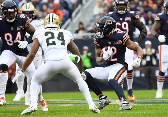Oct 20, 2019; Chicago, IL, USA; Chicago Bears wide receiver Allen Robinson (12) makes a catch on New Orleans Saints strong safety Vonn Bell (24) during the first half at Soldier Field. Mandatory Credit: Mike DiNovo-USA TODAY Sports