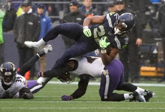 Oct 20, 2019; Seattle, WA, USA; Seattle Seahawks running back C.J. Prosise (22) is tackled by Baltimore Ravens free safety Earl Thomas (29) in the second quarter at CenturyLink Field. The Ravens defeated the Seahawks 30-16.  Mandatory Credit: Kirby Lee-USA TODAY Sports
