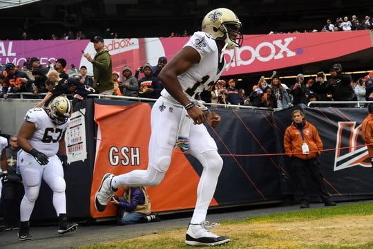 Oct 20, 2019; Chicago, IL, USA; New Orleans Saints wide receiver Michael Thomas (13) takes the field before the game against the Chicago Bears at Soldier Field. Mandatory Credit: Mike DiNovo-USA TODAY Sports