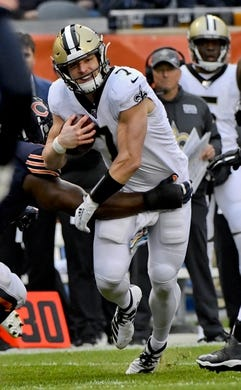 Oct 20, 2019; Chicago, IL, USA; New Orleans Saints quarterback Taysom Hill (7) runs against the Chicago Bears during the second half at Soldier Field. Mandatory Credit: Matt Marton-USA TODAY Sports
