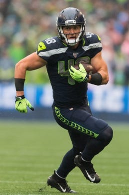 Oct 20, 2019; Seattle, WA, USA; Seattle Seahawks tight end Jacob Hollister (48) carries the ball after a catch against the Baltimore Ravens during the first half at CenturyLink Field. Baltimore defeated Seattle 30-16. Mandatory Credit: Steven Bisig-USA TODAY Sports