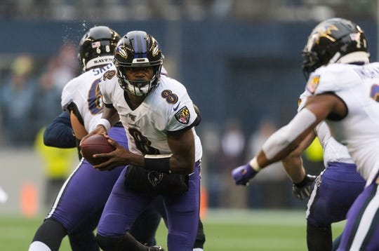 Oct 20, 2019; Seattle, WA, USA; Baltimore Ravens quarterback Lamar Jackson (8) during the first half against the Seattle Seahawks at CenturyLink Field. Baltimore defeated Seattle 30-16. Mandatory Credit: Steven Bisig-USA TODAY Sports