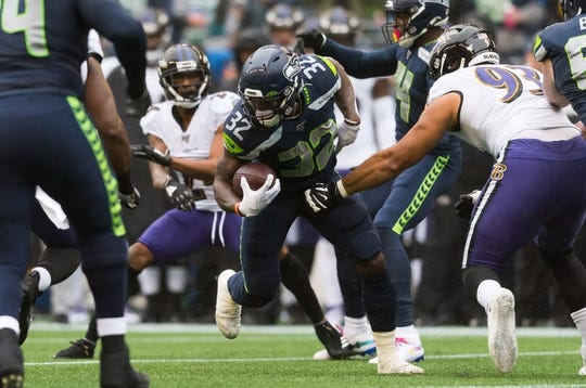 Oct 20, 2019; Seattle, WA, USA; Seattle Seahawks running back Chris Carson (32) carries the ball against the Baltimore Ravens during the first half at CenturyLink Field. Baltimore defeated Seattle 30-16. Mandatory Credit: Steven Bisig-USA TODAY Sports