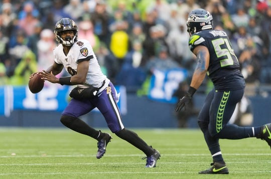 Oct 20, 2019; Seattle, WA, USA; Baltimore Ravens quarterback Lamar Jackson (8) looks for an open receiver while being defended by Seattle Seahawks middle linebacker Bobby Wagner (54) during the second half at CenturyLink Field. Baltimore defeated Seattle 30-16. Mandatory Credit: Steven Bisig-USA TODAY Sports