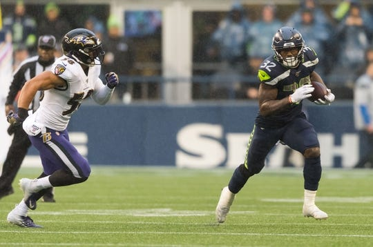 Oct 20, 2019; Seattle, WA, USA; Seattle Seahawks running back Chris Carson (32) carries the ball while being chased by Baltimore Ravens linebacker L.J. Fort (58) during the second half at CenturyLink Field. Baltimore defeated Seattle 30-16. Mandatory Credit: Steven Bisig-USA TODAY Sports