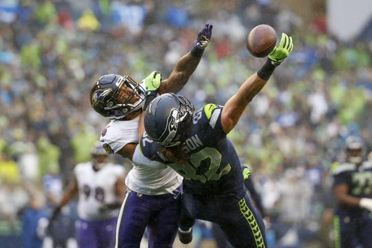 Oct 20, 2019; Seattle, WA, USA; Baltimore Ravens defensive back Chuck Clark (36) defends a pass intended for Seattle Seahawks tight end Luke Willson (82) during the second quarter at CenturyLink Field. Mandatory Credit: Joe Nicholson-USA TODAY Sports