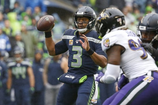 Oct 20, 2019; Seattle, WA, USA; Seattle Seahawks quarterback Russell Wilson (3) pump fakes against the Baltimore Ravens during the first quarter at CenturyLink Field. Mandatory Credit: Joe Nicholson-USA TODAY Sports
