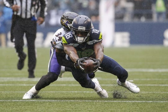Oct 20, 2019; Seattle, WA, USA; Seattle Seahawks wide receiver Jaron Brown (18) reaches out for extra yardage after making a reception against the Baltimore Ravens during the second quarter at CenturyLink Field. Mandatory Credit: Joe Nicholson-USA TODAY Sports