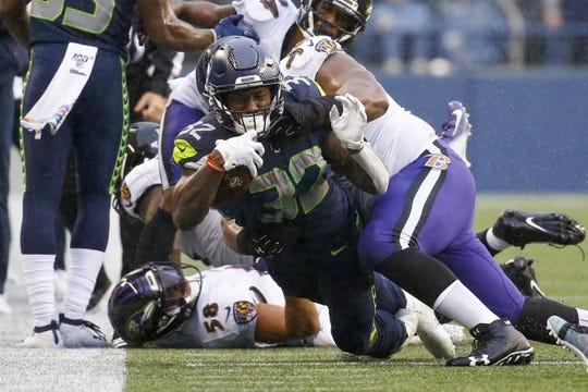 Oct 20, 2019; Seattle, WA, USA; Seattle Seahawks running back Chris Carson (32) rushes against the Baltimore Ravens during the third quarter at CenturyLink Field. Mandatory Credit: Joe Nicholson-USA TODAY Sports