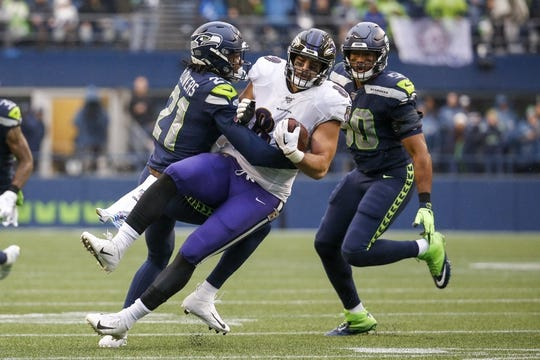 Oct 20, 2019; Seattle, WA, USA; Seattle Seahawks cornerback Tre Flowers (21) tackles Baltimore Ravens tight end Mark Andrews (89) after making a reception during the second quarter at CenturyLink Field. Mandatory Credit: Joe Nicholson-USA TODAY Sports