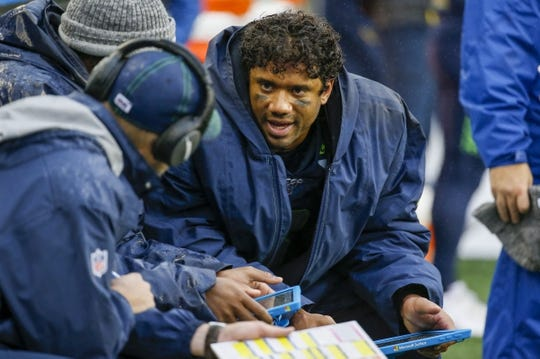 Oct 20, 2019; Seattle, WA, USA; Seattle Seahawks quarterback Russell Wilson (3) talks with coaching staff on the sideline during the third quarter against the Baltimore Ravens at CenturyLink Field. Mandatory Credit: Joe Nicholson-USA TODAY Sports