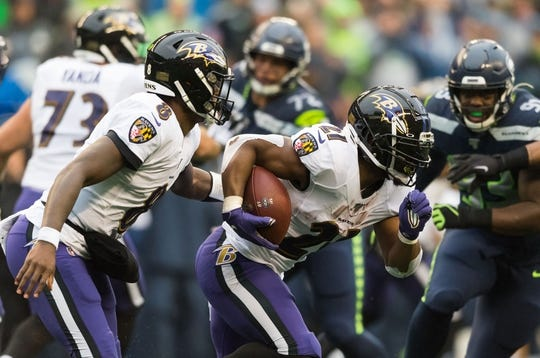 Oct 20, 2019; Seattle, WA, USA; Baltimore Ravens running back Mark Ingram (21) carries the ball during the second half against the Seattle Seahawks at CenturyLink Field. Baltimore defeated Seattle 30-16. Mandatory Credit: Steven Bisig-USA TODAY Sports