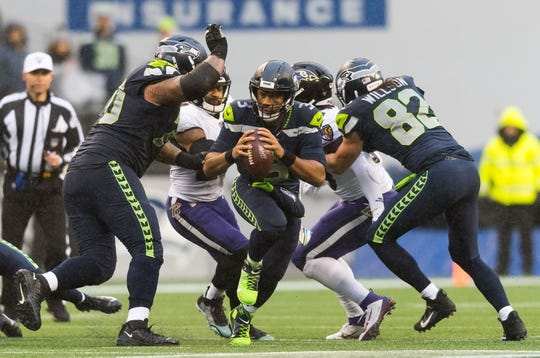 Oct 20, 2019; Seattle, WA, USA; Seattle Seahawks quarterback Russell Wilson (3) carries the ball against the Baltimore Ravens during the second half at CenturyLink Field. Baltimore defeated Seattle 30-16. Mandatory Credit: Steven Bisig-USA TODAY Sports