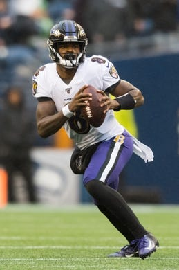 Oct 20, 2019; Seattle, WA, USA; Baltimore Ravens quarterback Lamar Jackson (8) during the second half against the Seattle Seahawks at CenturyLink Field. Baltimore defeated Seattle 30-16. Mandatory Credit: Steven Bisig-USA TODAY Sports
