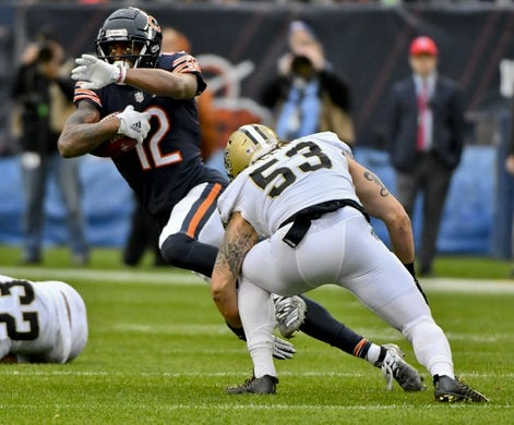 Oct 20, 2019; Chicago, IL, USA; Chicago Bears wide receiver Allen Robinson (12) runs with the ball against New Orleans Saints outside linebacker A.J. Klein (53) during the first half at Soldier Field. Mandatory Credit: Matt Marton-USA TODAY Sports