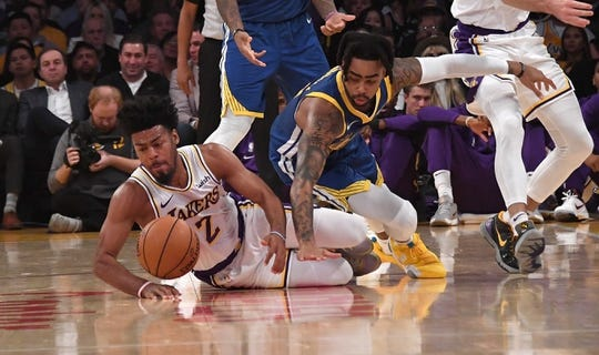 Oct 16, 2019; Los Angeles, CA, USA; Los Angeles Lakers guard Quinn Cook (2) and Golden State Warriors guard D'Angelo Russell (0) battle for the ball  in the first half at Staples Center. The Lakers defeated the Warriors 126-93. Mandatory Credit: Kirby Lee-USA TODAY Sports