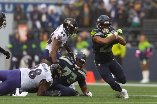 Oct 20, 2019; Seattle, WA, USA; Seattle Seahawks running back C.J. Prosise (22) during the first half at CenturyLink Field. Baltimore defeated Seattle 30-16. Mandatory Credit: Steven Bisig-USA TODAY Sports
