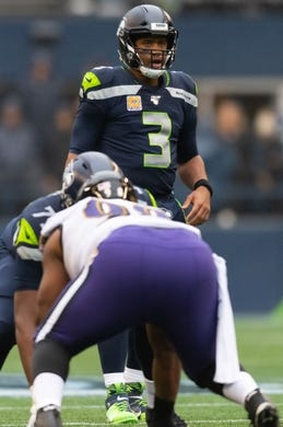 Oct 20, 2019; Seattle, WA, USA; Seattle Seahawks quarterback Russell Wilson (3) during the first half at CenturyLink Field. Baltimore defeated Seattle 30-16. Mandatory Credit: Steven Bisig-USA TODAY Sports