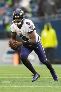 Oct 20, 2019; Seattle, WA, USA; Baltimore Ravens quarterback Lamar Jackson (8) during the second half at CenturyLink Field. Baltimore defeated Seattle 30-16. Mandatory Credit: Steven Bisig-USA TODAY Sports