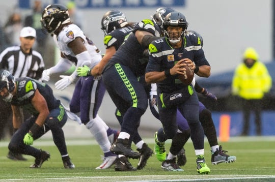 Oct 20, 2019; Seattle, WA, USA; Seattle Seahawks quarterback Russell Wilson (3) during the second half at CenturyLink Field. Baltimore defeated Seattle 30-16. Mandatory Credit: Steven Bisig-USA TODAY Sports
