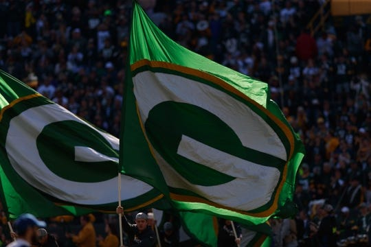 Oct 20, 2019; Green Bay, WI, USA; A Green Bay Packers flag prior to the game against the Oakland Raiders at Lambeau Field. Mandatory Credit: Jeff Hanisch-USA TODAY Sports