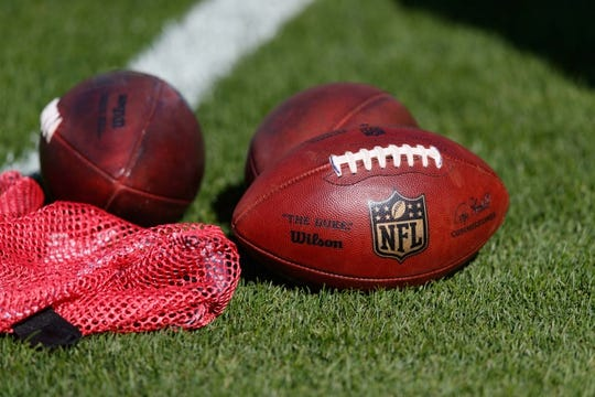 Oct 20, 2019; Green Bay, WI, USA; Footballs sit on the field prior to the game between the Oakland Raiders and Green Bay Packers at Lambeau Field. Mandatory Credit: Jeff Hanisch-USA TODAY Sports