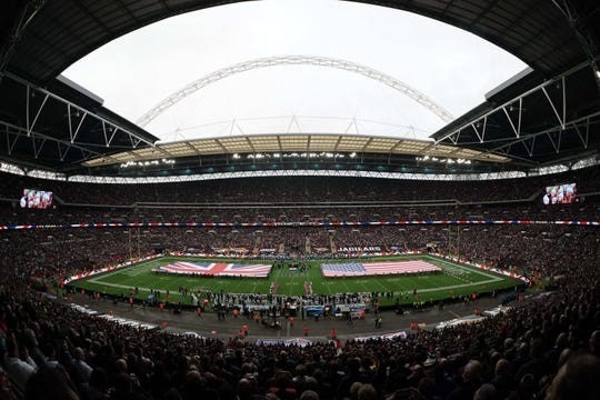 Nov 3, 2019; London, United Kingdom; General overall view of British and United States flags on the field  during the playing of the national anthem before an NFL International Series game between the Jacksonville Jaguars and the Houston Texans at Wembley Stadium. Mandatory Credit: Kirby Lee-USA TODAY Sports