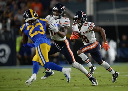 November 17, 2019; Los Angeles, CA, USA; Chicago Bears wide receiver Taylor Gabriel (18) runs the ball as wide receiver Anthony Miller (17) provides coverage against Los Angeles Rams defensive back Nickell Robey-Coleman (23) during the first half at the Los Angeles Memorial Coliseum. Mandatory Credit: Gary A. Vasquez-USA TODAY Sports