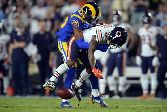 November 17, 2019; Los Angeles, CA, USA; Chicago Bears wide receiver Taylor Gabriel (18) is brought down by Los Angeles Rams cornerback Jalen Ramsey (20) during the first half at the Los Angeles Memorial Coliseum. Mandatory Credit: Gary A. Vasquez-USA TODAY Sports