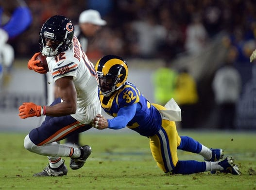November 17, 2019; Los Angeles, CA, USA; Chicago Bears wide receiver Allen Robinson (12) is brought down by Los Angeles Rams free safety Eric Weddle (32) during the first half at the Los Angeles Memorial Coliseum. Mandatory Credit: Gary A. Vasquez-USA TODAY Sports