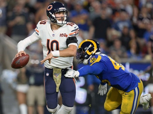 November 17, 2019; Los Angeles, CA, USA; Chicago Bears quarterback Mitchell Trubisky (10) moves out under pressure from Los Angeles Rams linebacker Obo Okoronkwo (45) during the first half at the Los Angeles Memorial Coliseum. Mandatory Credit: Gary A. Vasquez-USA TODAY Sports