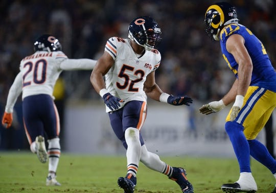 November 17, 2019; Los Angeles, CA, USA; Chicago Bears outside linebacker Khalil Mack (52) defends against Los Angeles Rams offensive tackle Andrew Whitworth (77) during the first half at the Los Angeles Memorial Coliseum. Mandatory Credit: Gary A. Vasquez-USA TODAY Sports