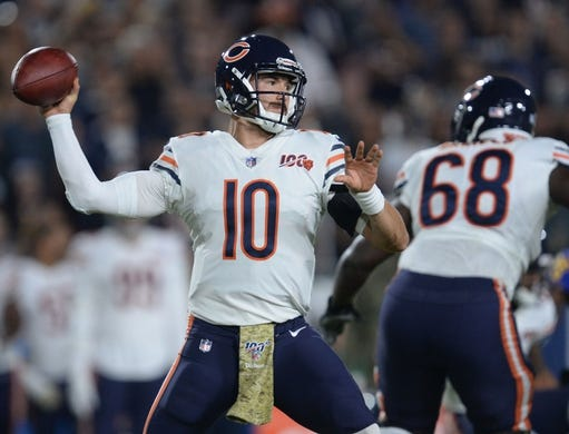 November 17, 2019; Los Angeles, CA, USA; Chicago Bears quarterback Mitchell Trubisky (10) throws as center James Daniels (68) provides coverage against the Los Angeles Rams during the first half at the Los Angeles Memorial Coliseum. Mandatory Credit: Gary A. Vasquez-USA TODAY Sports