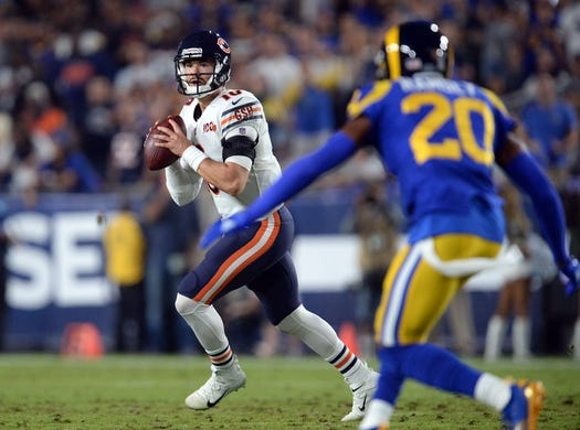 November 17, 2019; Los Angeles, CA, USA; Chicago Bears quarterback Mitchell Trubisky (10) moves out to pass as Los Angeles Rams cornerback Jalen Ramsey (20) defends during the first half at the Los Angeles Memorial Coliseum. Mandatory Credit: Gary A. Vasquez-USA TODAY Sports